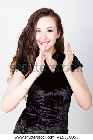 young woman's portrait with different happy emotions. she claps her hands - stock photo