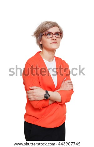 Young woman sad and lonely. Girl in red jacket and glasses disappointed hugging herself and looking up, feeling cold, upset and depressed isolated at white background. Emotional female portrait - stock photo