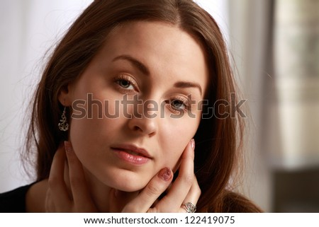 Young woman sad emotions cupping face