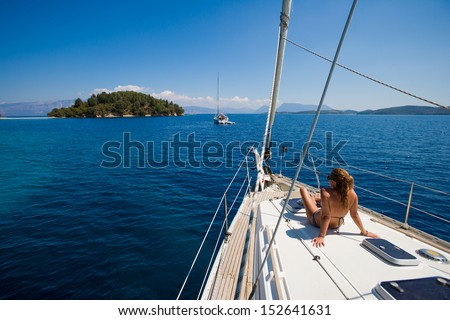 Young woman Sailing On Yacht in Greece  - stock photo