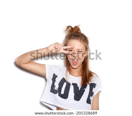 Young woman saluting and winking. White background, not isolated - stock photo