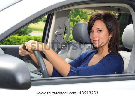 Young Woman Sat In The Drivers Seat of Her Car - stock photo