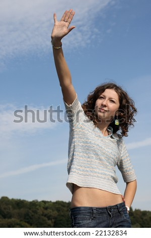 Young woman say hello - stock photo