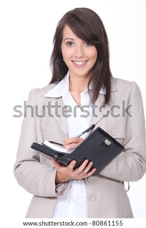 Young woman scheduling an appointment - stock photo