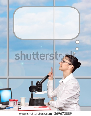 young woman scientific researcher sitting in laboratory and thinking - stock photo