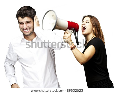 young woman screaming a man with the megaphone over white - stock photo