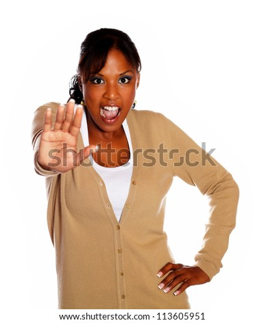 Young woman screaming and giving the high against white background