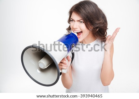 Young woman screaming into megaphone isolated on a white background - stock photo