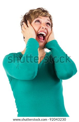 Young woman screaming. Isolated studio shot against a white background with copy space. - stock photo