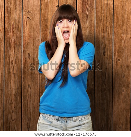 young woman screaming on wall - stock photo