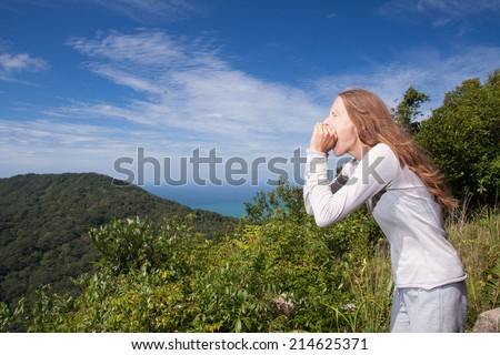 young woman screams in the mountains - stock photo