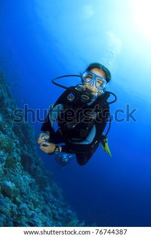 Young Woman Scuba Diving - stock photo