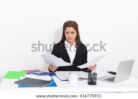 Young woman searching where is problem? - stock photo