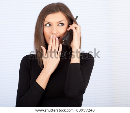 young woman, secretary speaks by a mobile phone - stock photo