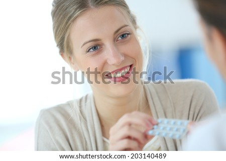 Young woman seing doctor for birth control pills - stock photo