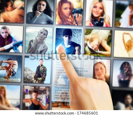 Young woman selecting friends on social network screen.