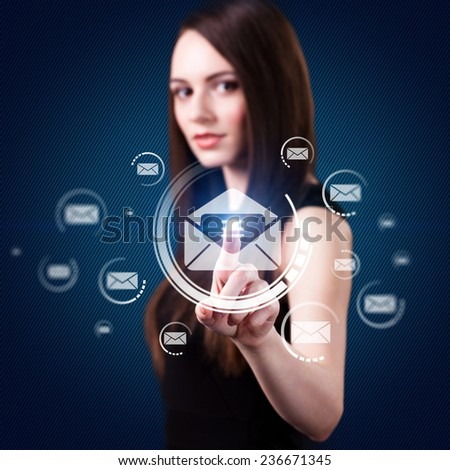 young woman selecting virtually an email out of many - stock photo