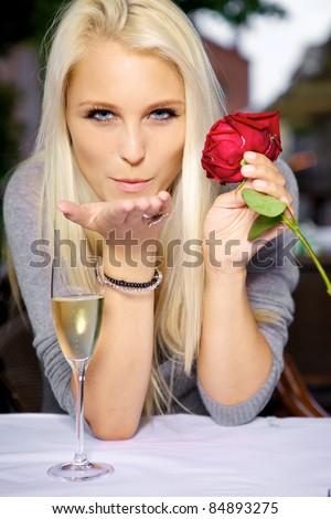 Young woman sending a romantic blow kiss. - stock photo
