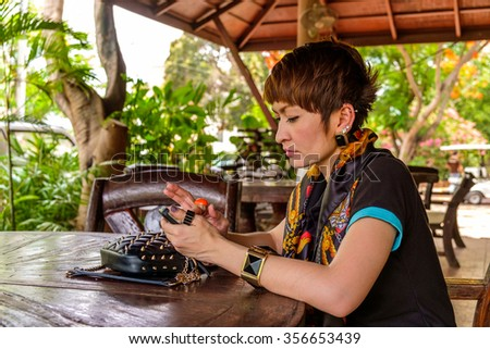 Young woman, serious with smart phone - stock photo