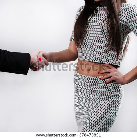 Young woman shaking a man's hands - stock photo
