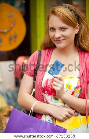 Young woman shopping at a mall - stock photo