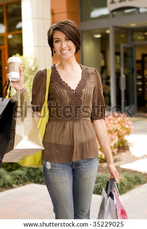 Young woman shopping at an outdoor mall - stock photo