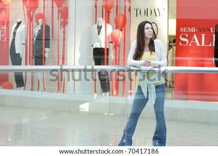 Young woman shopping at the mall for sales - stock photo