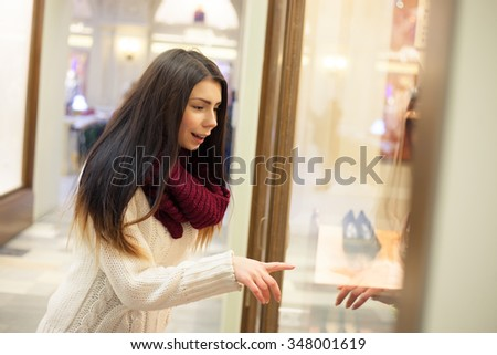 Young Woman Shopping At The Mall Starring Window With GoodsAttractive Shopper Girl