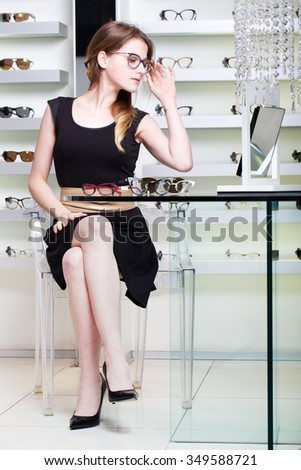 Young Woman Shopping For New Glasses