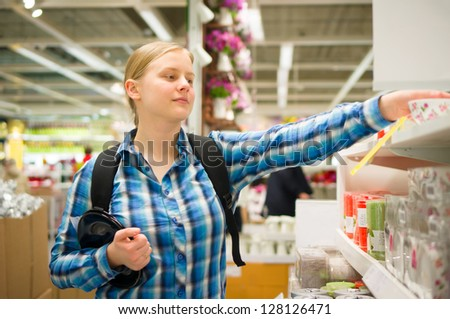 Young woman shopping   in department store - stock photo