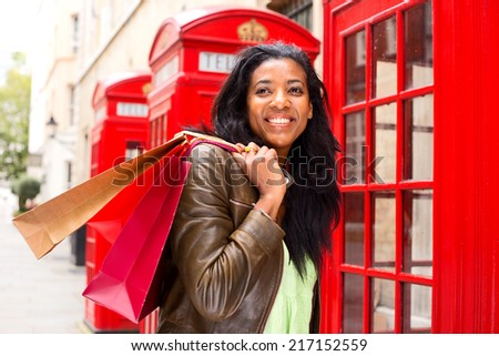 young woman shopping in london - stock photo