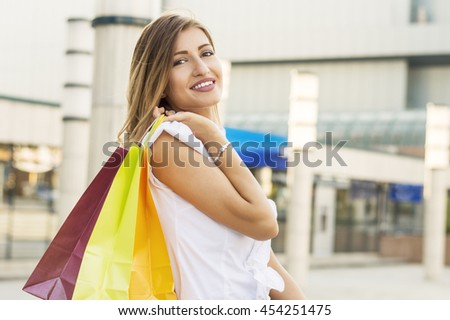Young woman shopping in the downtown - stock photo