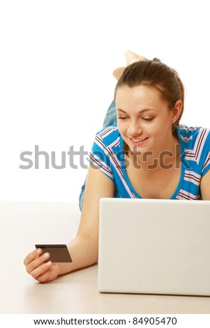 Young woman shopping on the Internet with credit card