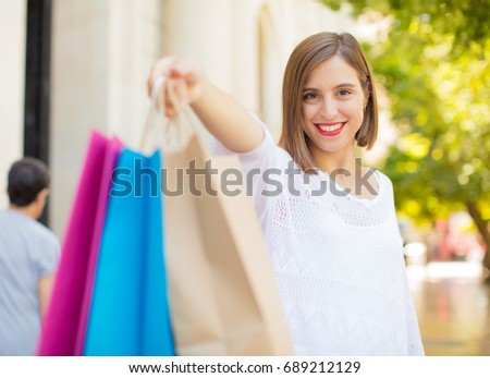 young woman shopping smiling