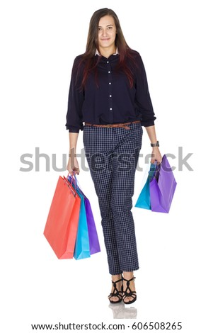 Young woman shopping with colorful bags