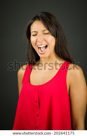 Young woman shouting in excitement - stock photo