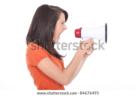 young woman shouting through a megaphone - stock photo