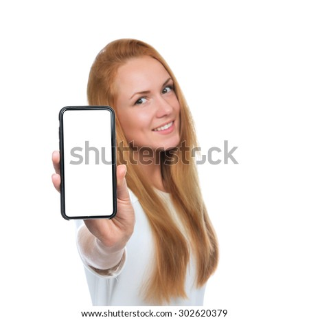 Young woman show display of mobile cell phone with blank screen and smiling isolated on a white background. Focus on hand with mobile phone - stock photo