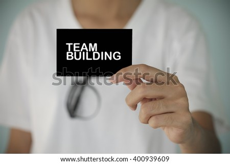 young woman show TEAM BUILDING   , business idea ,business concept ,business analysis - stock photo