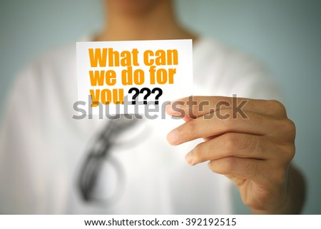 young woman show WHAT CAN WE DO FOR YOU on card , business idea - stock photo