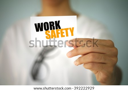 young woman show WORK SAFETY on card , business idea ,business concept ,business analysis - stock photo
