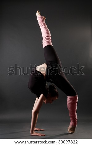 Young Woman Showing Beautiful Gymnastic Pose Stock Photo