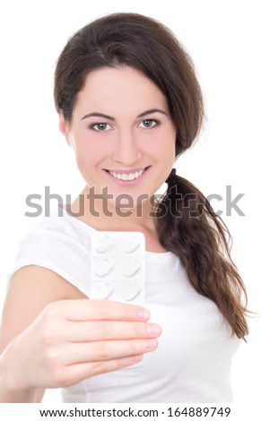young woman showing blister of pills isolated on white background