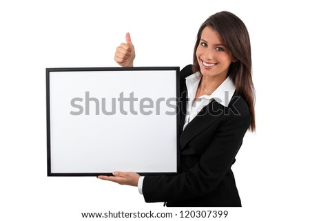 Young woman showing board - stock photo