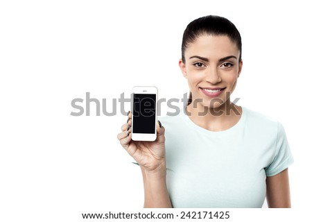 Young woman showing brand new cell phone - stock photo
