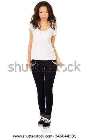 Young woman showing empty pockets. - stock photo