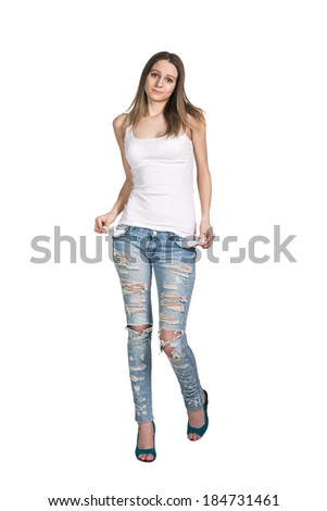 young woman showing empty pockets. isolated on white background - stock photo