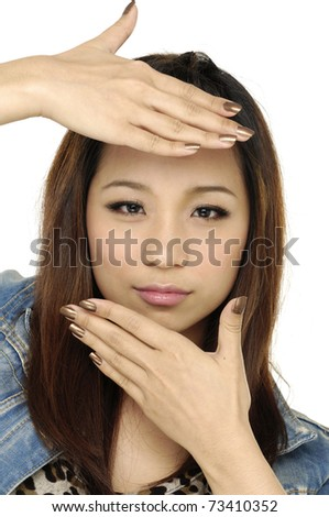 Young woman showing framing hand gesture - stock photo