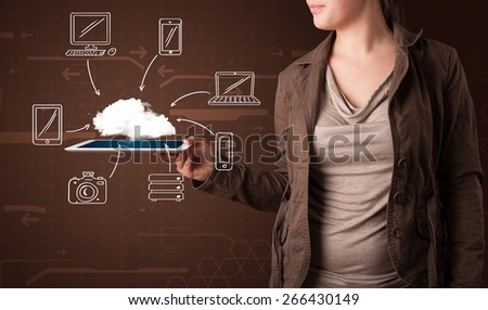 Young woman showing hand drawn cloud computing - stock photo