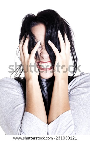 Young woman showing her anger towards someone over a white background. - stock photo
